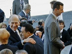 Olmert e Assad: frieza (Reuters)